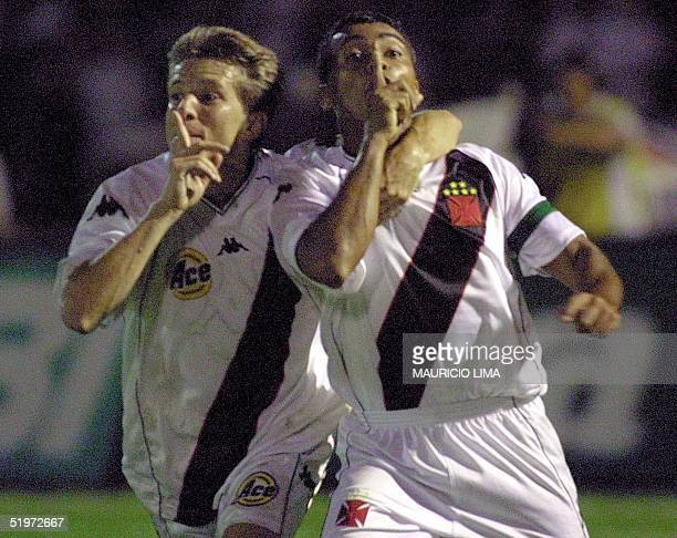 Romario and Juninho celebrate the fourth goal of their team Vasco da Gama against Palmeiras 20 December 2000 during the Mercosur Cup final at the...