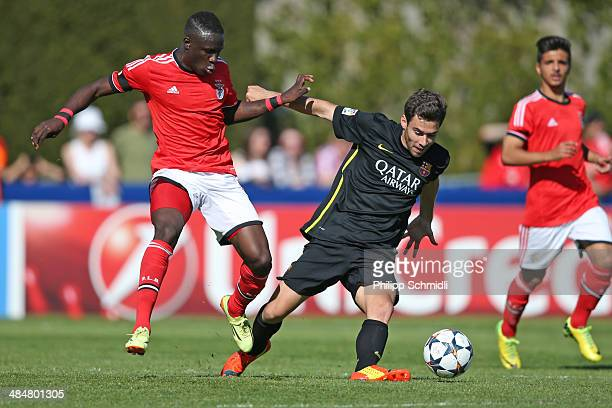 Romario Balde of SL Benfica fights for the ball with Jordi Ortega of FC Barcelona during the UEFA Youth League Final match between Benfica Lisbon and...