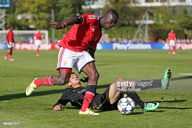 Romario Balde of SL Benfica fights for the ball with Mohamed El Ouriachi of FC Barcelona during the UEFA Youth League Final match between Benfica...
