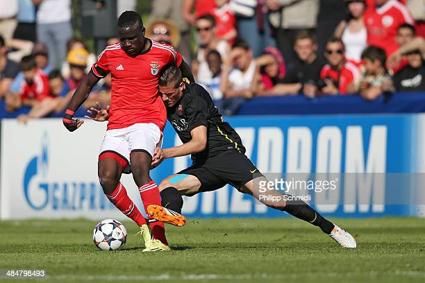 Romario Balde of SL Benfica fights for the ball with Rodrigo Tarin of FC Barcelona during the UEFA Youth League Final match between Benfica Lisbon...