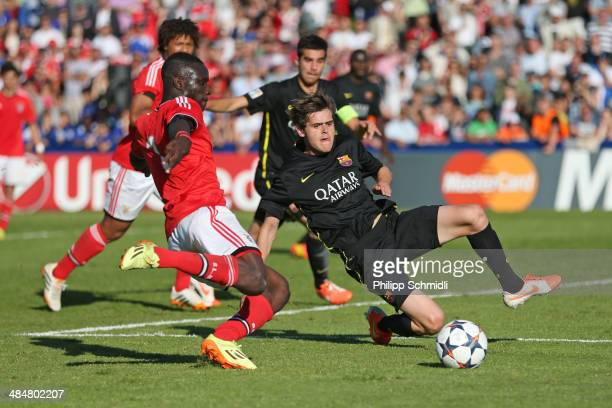 Romario Balde of SL Benfica fights for the ball with Xavi Quintilla of FC Barcelona during the UEFA Youth League Final match between Benfica Lisbon...