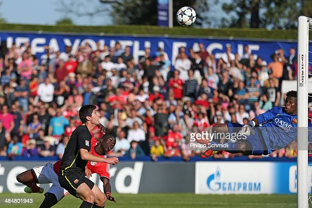 Romario Balde of SL Benfica misses a chance at goal against goalkeeper Fabrice Ondoa and Juan Antonio of FC Barcelona during the UEFA Youth League...