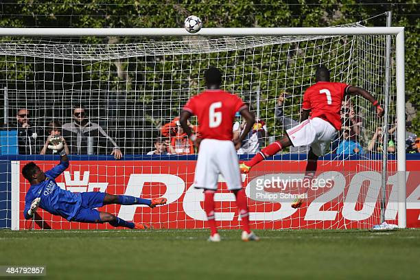 Romario Balde of SL Benfica misses a chance at goal from the penalty spot against goalkeeper Fabrice Ondoa of FC Barcelona during the UEFA Youth...