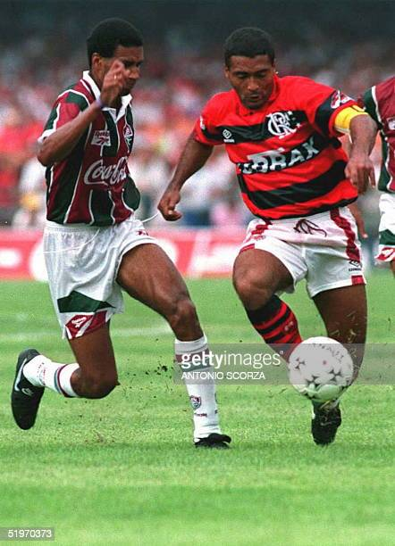 Romario playing his first game with his new club Flamengo passes a defenseman for Fluminense 12 February at Maracana stadium in Rio de Janiero...