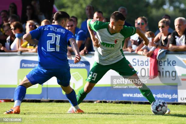 Romario Roesch of Augsburg and Christos Nikiforidis of Olching compete for the ball during the preseason friendly match between SC Olching and FC...
