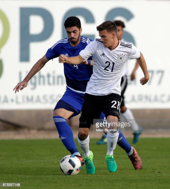 Romario Roesch of Germany in action against Zacharias Adoni of Cyprus during the U19 International Friendly between U19 Cyprus and U19 Germany at...