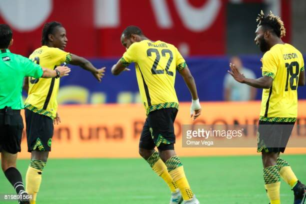 Romario Williams of Jamaica celebrates with teammates after scoring the second goal of his team during the CONCACAF Gold Cup Quarterfinal match...