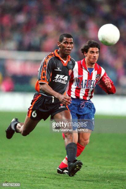 Roma's Aldair is watched by Atletico Madrid's Lardin
