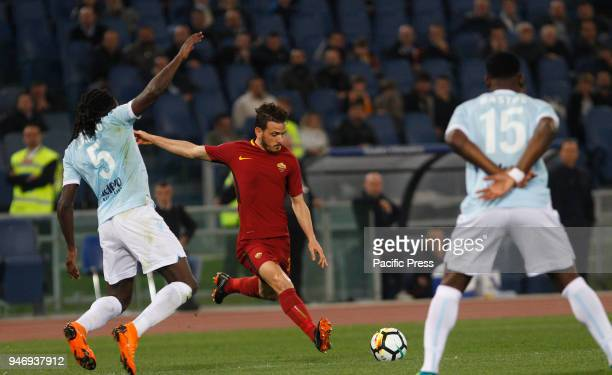 Roma's Alessandro Florenzi center is challenged by Lazio s Jordan Lukaku left and Bastos during the Serie A soccer match between Lazio and Roma at...