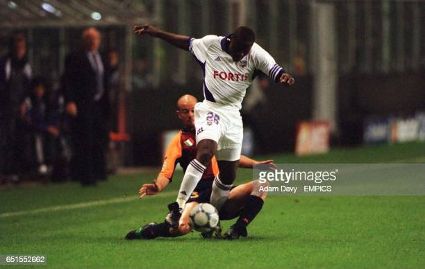 Roma's Antonio Zago slides in on Anderlecht's Aruna Dindane