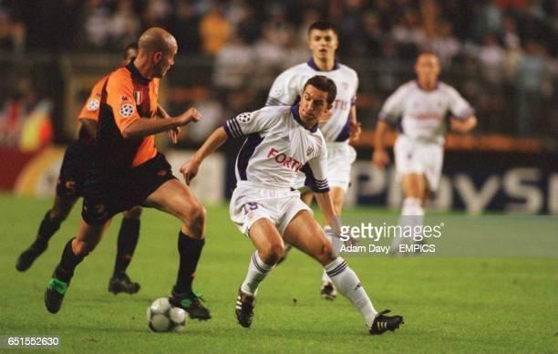 Roma's Antonio Zago tracks Anderlechts Ivica Mornar