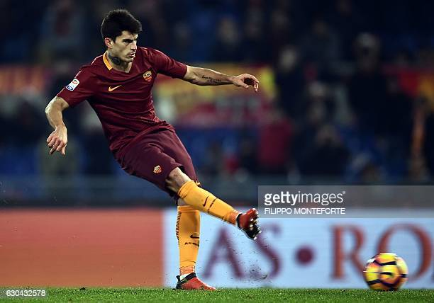 Roma's Argentinan midfielder Diego Perotti shoots a penalty kick to score during the italian Serie A football match between Roma and Chievo Verona on...