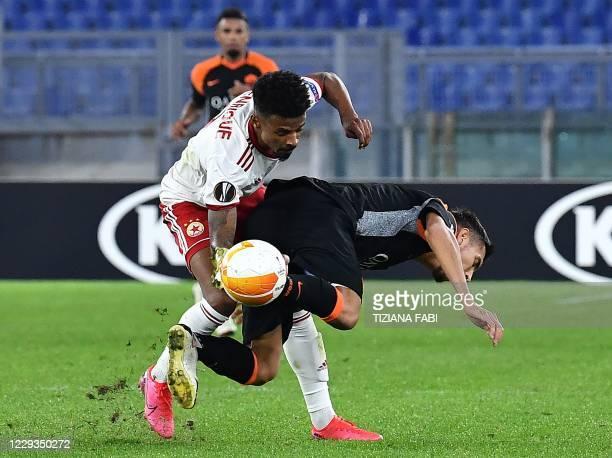 Roma's Argentine defender Federico Fazio collides with CSKA Sofia's Brazilian forward Henrique during the UEFA Europa League Group A first-leg...