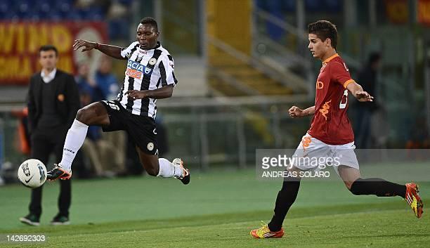 Roma's Argentine forward Erik Manuel Lamela fights for the ball against Udinese's Ghanaian midfielder Asamoah Kwadwo during the Italian Serie A...