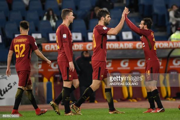 Roma's Argentinian defender Federico Fazio celebrates with his teammate Roma's Italian midfielder Alessandro Florenzi after scoring during the...