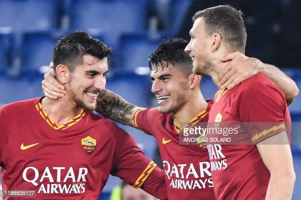 AS Roma's Argentinian forward Diego Perotti celebrates with AS Roma's Italian midfielder Lorenzo Pellegrini and AS Roma's Bosnian forward Edin Dzeko...
