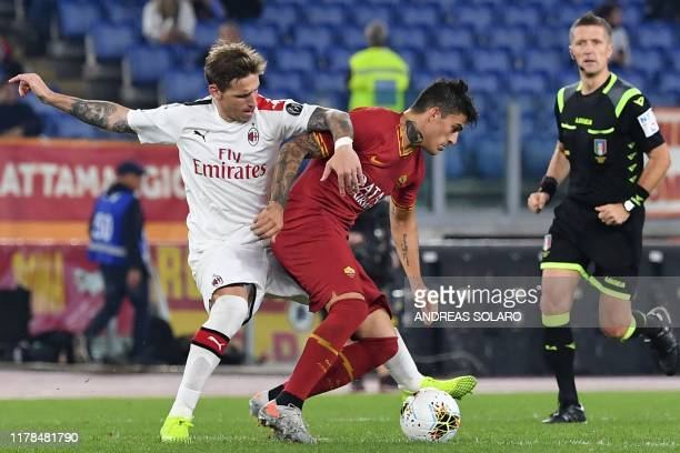 Roma's Argentinian forward Diego Perotti vies with AC Milan's Argentinian midfielder Lucas Biglia during the Italian Serie A football match between...