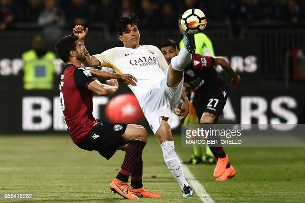 AS Roma's Argentinian forward Jonathan Silva vies for the ball with Cagliari's Italian defender Paolo Farago during the Italian Serie A football...