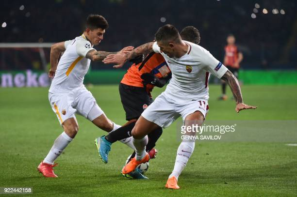 Roma's Argentinian midfielder Diego Perotti and Roma's Croatian defender Aleksandar Kolarov vie for the ball during the UEFA Champions League round...