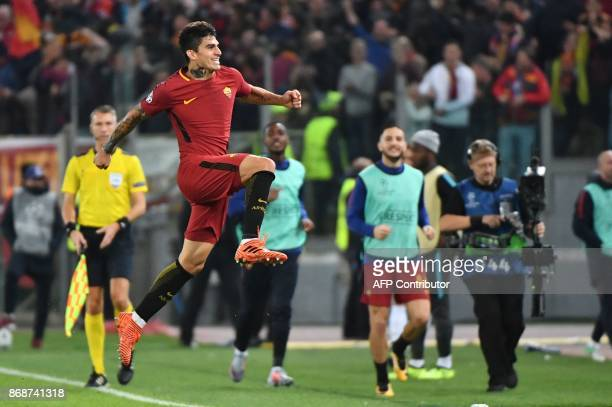 Roma's Argentinian midfielder Diego Perotti celebrates after scoring during the UEFA Champions League football match AS Roma vs Chelsea on October 31...