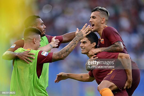 Roma's Argentinian midfielder Diego Perotti celebrates with his teammate Argentinian midfielder Leandro Paredes during the Italian Serie A football...