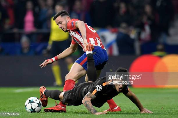 Roma's Argentinian midfielder Diego Perotti challenges Atletico Madrid's Spanish midfielder Saul Niguez during the UEFA Champions League group C...