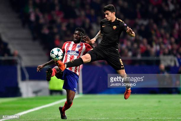 Roma's Argentinian midfielder Diego Perotti challenges Atletico Madrid's Ghanaian midfielder Thomas during the UEFA Champions League group C football...