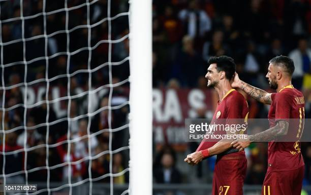 Roma's Argentinian midfielder Javier Pastore celebrates with Roma's Serbian defender Aleksandar Kolarov after scoring a goal during the Serie A...