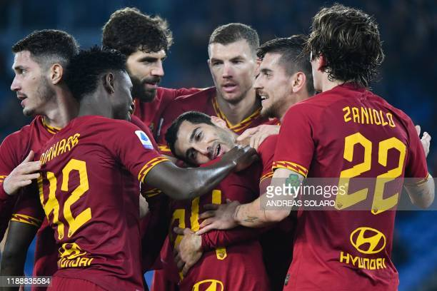AS Roma's Armenian midfielder Henrik Mkhitaryan celebrates with teammates after scoring during the Italian Serie A football match AS Roma vs Spal on...