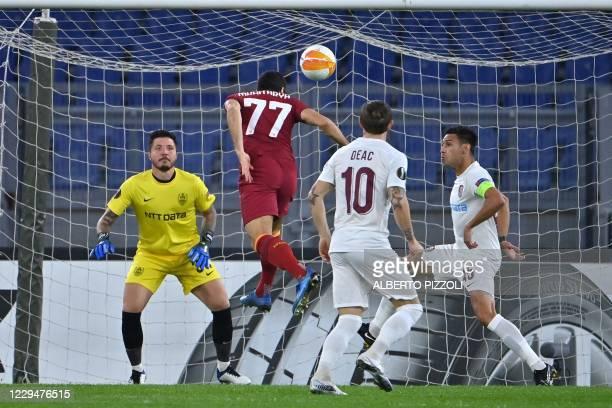Roma's Armenian midfielder Henrikh Mkhitaryan scores a goal during the UEFA Europa League Group A football match Roma vs CFR Cluj on November 5, 2020...