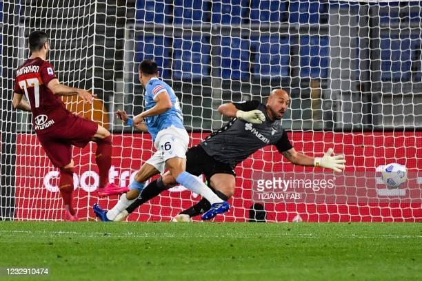 Roma's Armenian midfielder Henrikh Mkhitaryan shoots to open the scoring past Lazio's Spanish goalkeeper Pepe Reina during the Italian Serie A...