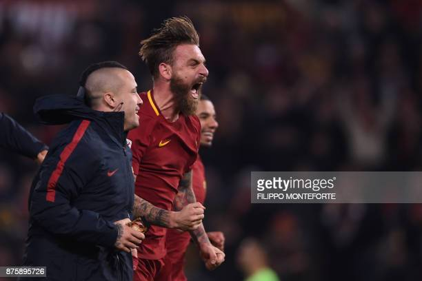 Roma's Belgian midfielder Radja Nainggolan and Roma's Italian midfielder Daniele De Rossi celebrate at the end of the Italian Serie A football match...