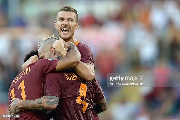 Roma's Belgian midfielder Radja Nainggolan celebrates with his teammates Egyptian midfielder Mohamed Salah and Macedonian forward Edin Dzeko during...