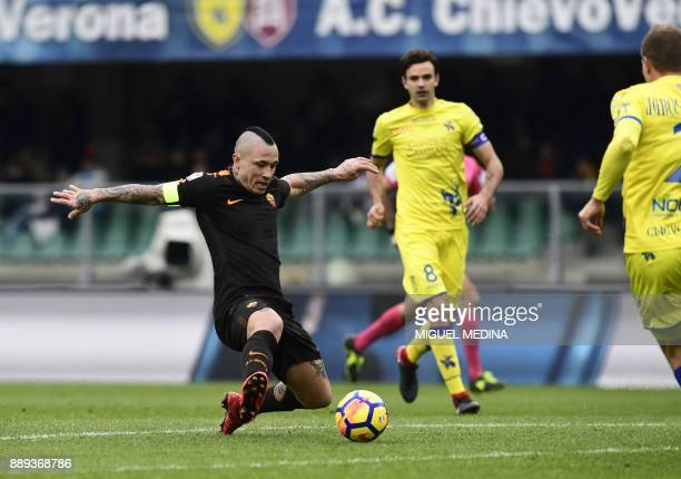 Roma's Belgian midfielder Radja Nainggolan controls the ball during the Italian Serie A football match between AC Chievo and AS Roma at the Bentegodi...