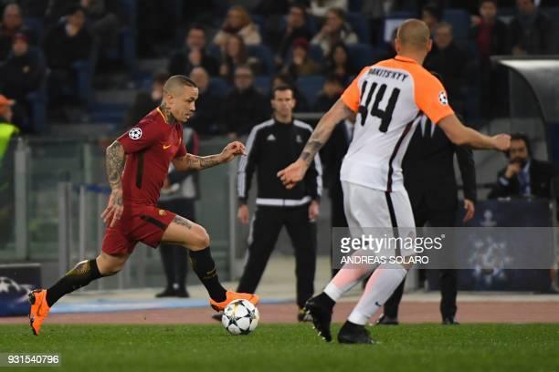 Roma's Belgian midfielder Radja Nainggolan controls the ball during the UEFA Champions League round of 16 second leg football match AS Roma vs...