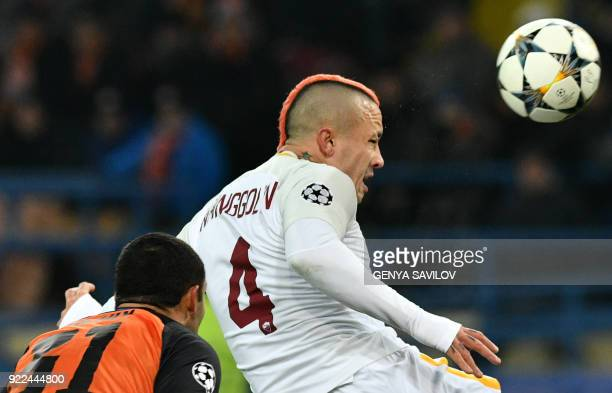 Roma's Belgian midfielder Radja Nainggolan fights for the ball with Shakhtar Donetsk's forward Ismaily during the UEFA Champions League round of 16...