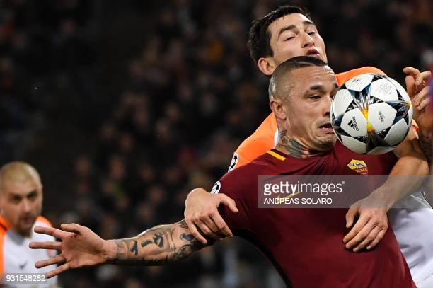 Roma's Belgian midfielder Radja Nainggolan fights for the ball with Shakhtar Donetsk's Ukrainian midfielder Taras Stepanenko during the UEFA...