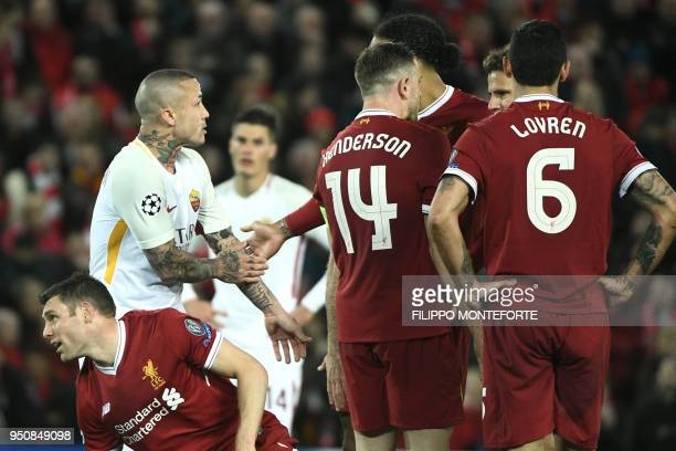Roma's Belgian midfielder Radja Nainggolan gestures for a hand ball against Liverpool's English midfielder James Milner during the UEFA Champions...
