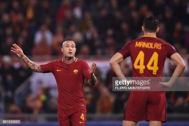 Roma's Belgian midfielder Radja Nainggolan reacts during the UEFA Champions League round of 16 second leg football match AS Roma vs Shakhtar Donetsk...