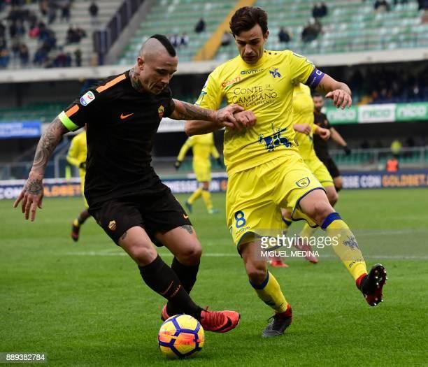 Roma's Belgian midfielder Radja Nainggolan vies with Chievo's Serbian midfielder Ivan Radovanovic during the Italian Serie A football match between...