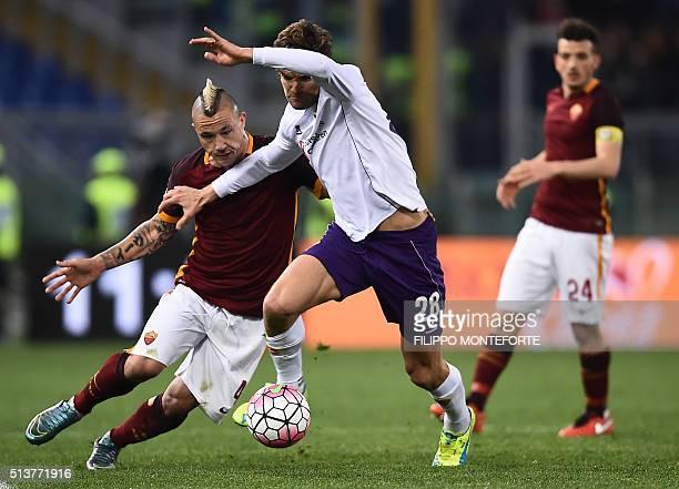 Roma's Belgian midfielder Radja Nainggolan vies with Fiorentina's Spanish defender Marcos Alonso Mendoza during the Italian Serie A football match AS...