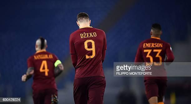 Roma's Bosnian forward Edin Dzeko celebrates after scoring a goal during the Italian Serie A football match between AS Roma and Chievo Verona at the...