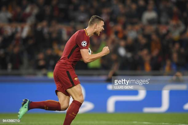 AS Roma's Bosnian forward Edin Dzeko celebrates after scoring the opening goal during the UEFA Champions League quarterfinal second leg football...