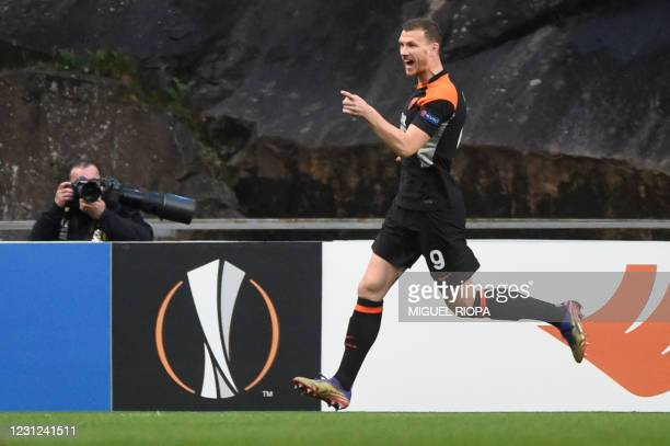 Roma's Bosnian forward Edin Dzeko celebrates scoring the opening goal during the UEFA Europa League round of 32 first leg football match between SC...