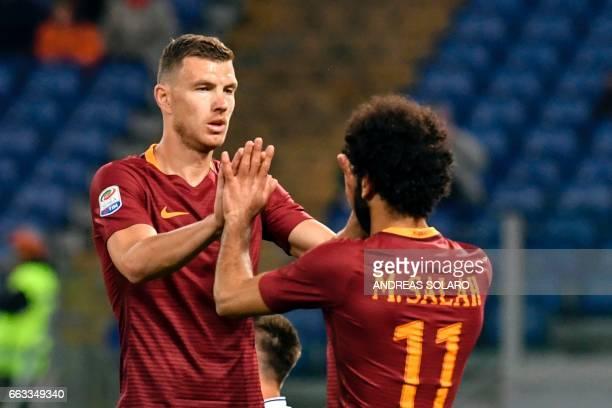 AS Roma's Bosnian forward Edin Dzeko celebrates with AS Roma's Egyptian midfielder Mohamed Salah after scoring a goal during the Italian Serie A...