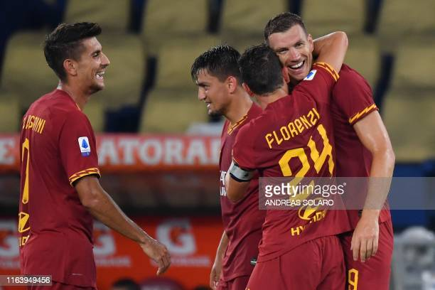 AS Roma's Bosnian forward Edin Dzeko celebrates with AS Roma's Italian midfielder Lorenzo Pellegrini AS Roma's Turkish forward Cengiz Under and AS...