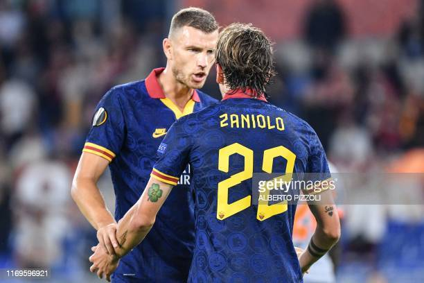Roma's Bosnian forward Edin Dzeko celebrates with AS Roma's Italian midfielder Nicolo Zaniolo after scoring during the UEFA Europa League Group J...