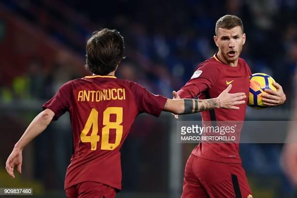 AS Roma's Bosnian forward Edin Dzeko celebrates with AS Roma's Italian midfielder Mirko Antonucci after scoring a goal during the Italian Serie A...