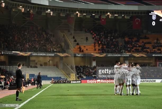 Roma's Bosnian forward Edin Dzeko celebrates with his teammates after scoring a goal during the UEFA Europa League Group J football match Istanbul...
