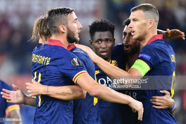 Roma's Bosnian forward Edin Dzeko celebrates with teammates after scoring during the UEFA Europa League Group J football match AS Roma vs Istanbul...